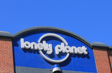 the publisher: Melbourne Australia - December 13, 2014: Lonely Planet, the largest travel guide book publisher in the world Editorial