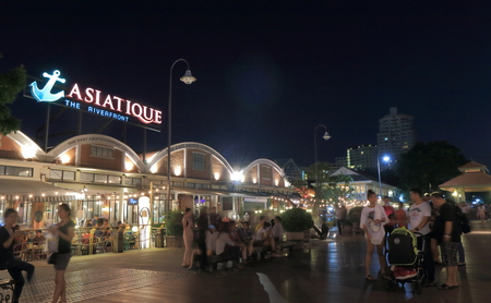 sightsee: Bangkok Thailand  April 19 2015: Unidentified people sightsee Asiatique shopping complex in Bangkok.