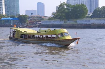 chao phraya river: Bangkok Thailand  April 20 2015: River boat taxi in Chao Phraya River in Bangkok.