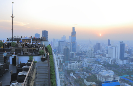 Bangkok Thailand  April 20 2015: Unidentified people watch Bangkok city view from rooftop bar in Bangkok. Editorial