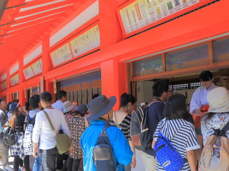 lucky charm: Kyoto Japan  May 5 2015: Unidentified people buy lucky charm at Fushimi Inari Shrine in Kyoto.