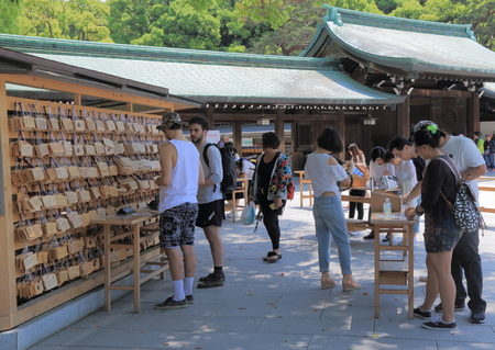 ema: Tokyo Japan - May 8, 2015: People writ Ema, wooden wishing plaques at Meiji Shrine in Tokyo Japan. Editorial
