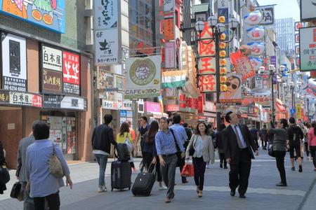 entertainment district: Osaka Japan - April 24, 2015: People visit Dotonbori entertainment district in Osaka.