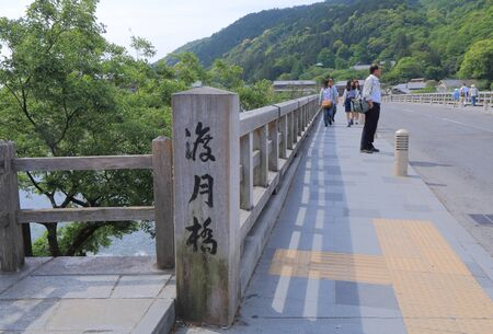 sightsee: Kyoto Japan - May 6, 2015: People sightsee Togetsu bridge in Kyoto. Editorial