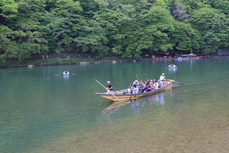 Kyoto Japan - May 6, 2015: Hozu river cruise and Kyoto mountains in Kyoto.