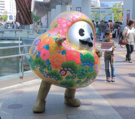 character poses: Kanazawa Japan - May 10, 2015: Kanazawa city mascot character poses for photos shoot at Kanazawa station.