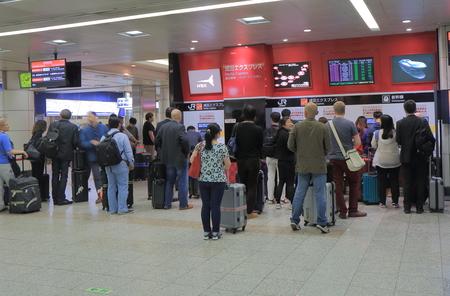 airport: Tokyo Japan - May 23, 2015: People buy tickets for Narita express at Narita Airport.