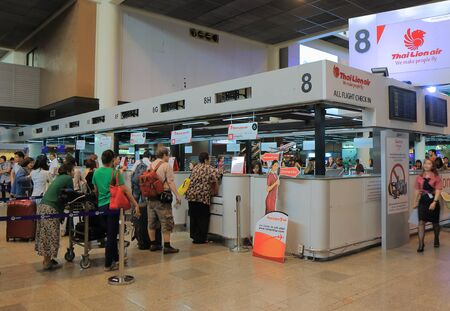 security check: Bangkok Thailand - April 23, 2015: People check in for Thai Lion Air flights at Don Mueang airport in Bangkok. Editorial