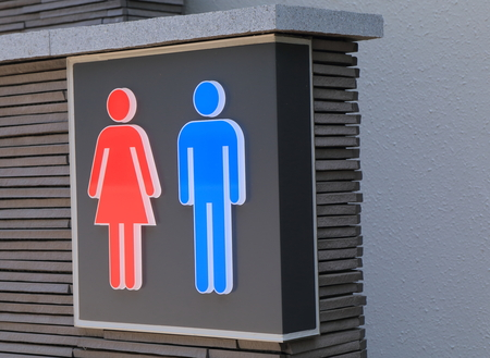 private access: Male and female toilet sign