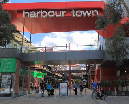 docklands: Melbourne Australia - August 22, 2015: People visit Docklands Harbour Town shopping complex.