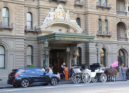 Melbourne Australia - September 19, 2015: Horse carriage parks at iconic The Hotel Windsor in Melbourne Australia. Editorial
