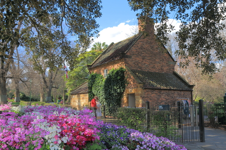 fitzroy: Melbourne Australia - September 19, 2015: Fitzroy Garden and Historical building Cooks cottage in background in Melbourne Australia. Editorial
