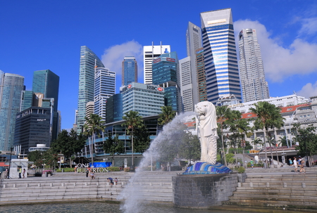 sightsee: Singapore - 28 May, 2014: People sightsee Singapore Skyline and Merlion. Editorial