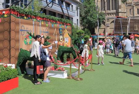 melbourne australia: Melbourne Australia - December 5, 2015: People salfie in front of Christmas decoration in Melbourne.