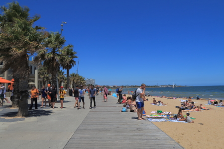 st kilda: Melbourne Australia - December 29, 2015: People visit St Kilda beach in Melbourne.