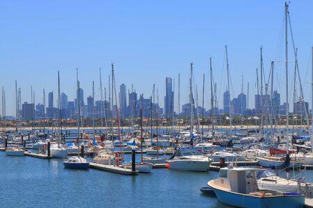 st kilda: Melbourne cityscape over St Kilda harbor Australia