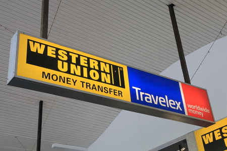 Melbourne Australia - February 13, 2016:Western Union and Travelex currency exchange transfer company 報道画像