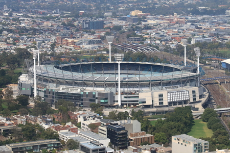 afl: Melbourne cityscape and Melbourne Cricket Ground Australia Editorial