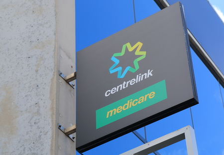government services: Melbourne Australia - August 14, 2016: Centrelink and Medicare office. Centrelink delivers a range of government payments and services for retirees, unemployed, families carers and more.