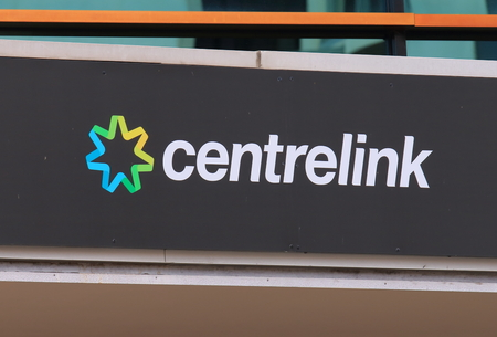 government services: Melbourne Australia - August 14, 2016: Centrelink office in Australia. Centrelink delivers a range of government payments and services for retirees, unemployed, families carers and more.