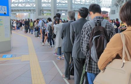 Kanazawa Japan-October18, 2016: Unidentified people queue at Kanazawa station bus terminal. Editorial