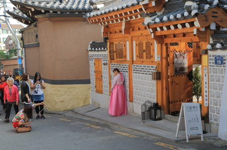 Seoul South Korea – October 19, 2016: Unidentified people visit Bukchon Hanok Village. Bukchon Hanok Village is preserved to show a 600-year-old urban environment
