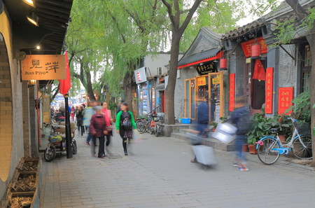 Beijing China - October 27, 2016: Unidentified people vist Nanluoguxiang lane. Nanluoguxiang lane has become a popular tourist destination with restaurants and bars. Sajtókép