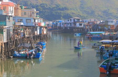lantau: Hong Kong - November 7, 2016: Unidentified people fish in Tai O fishermans village.