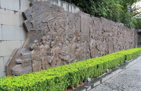 Communism Carving art at Peoples Square in Shanghai China