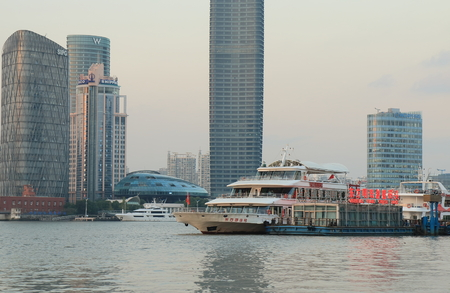 Shanghai China – November 2, 2016: River cruise boat moored along Huangpu River in Pudong.