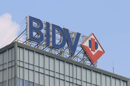 state owned: Hanoi Vietnam - Novrember 22, 2016: BIDV bank. BIDV Bank for Investment and Development of Vietnam is a large state owned bank founded in 1957. Editorial