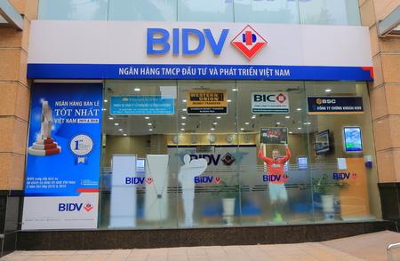 state owned: Hanoi Vietnam - Novrember 24, 2016: BIDV bank office. BIDV Bank for Investment and Development of Vietnam is a large state owned bank founded in 1957.