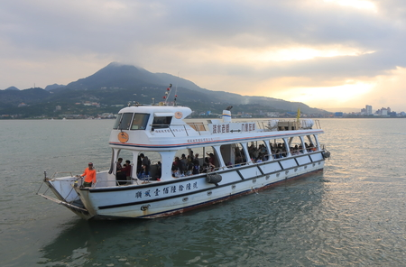 Taipei Taiwan - December 4, 2016: Unidentified people take Tamsui Harbour boat cruise. Editorial