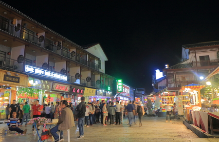 Yangshou China - November 18, 2016: Unidentified people visit West street. West street is a main commercial street with restaurants bars and gift shops. Editorial
