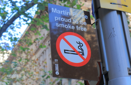 Sydney Australia - June 1, 2017: Smoke free sign at Martin Place in Sydney Australia. Martin Place is a prehistorian street with department stores and shops in downtown Sydney. Publikacyjne