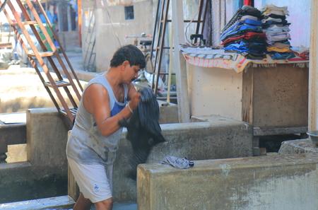 Mumbai India - October 12, 2017: Unidentified man works in Dhobi Ghat laundry Mumbai India.