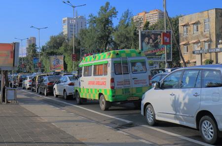Mumbai India - October 12, 2017: Ambulance in heavy traffic jam in Marine Drive downtown Mumbai India.