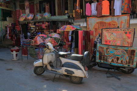 Udaipur India - October 15, 2017: Old motorbike parked at souvenir shop in Udaipur shopping street in Udaipur India.