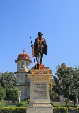 Udaipur India - October 16, 2017: Gulab Bagh Library and Mahhatma Gandhi statue in Udaipur India.