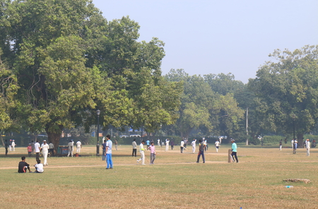 New Delhi India - October 29, 2017: People play cricket at August Kranti Maidan park New Delhi India Editorial