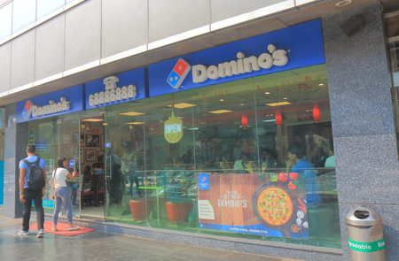 New Delhi India - October 29, 2017: People visit Dominos Pizza fast food restaurant in New Delhi India.