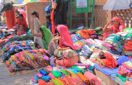Jodhpur India - October 19, 2017: People sell Sari traditional costume at Sardar street market in Jodhpur India. Stock Photo - 93999803