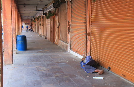 Jaipur India - October 20, 2017: Unidentified man sleeps on street in downtown New Delhi India