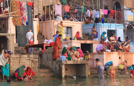 Varanasi India - October 31, 2017: People visit Ganges river Panchganga ghat in Varanasi India.