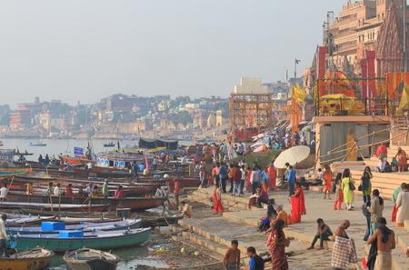 Varanasi India - November 2, 2017: People visit Ganges river Manmandir ghat in Varanasi India. Editorial
