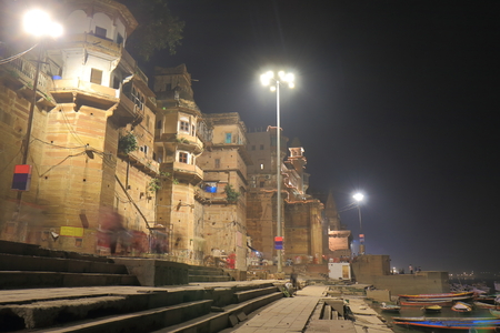 Ganges river Rana Mahal ghat night cityscape Varanasi India