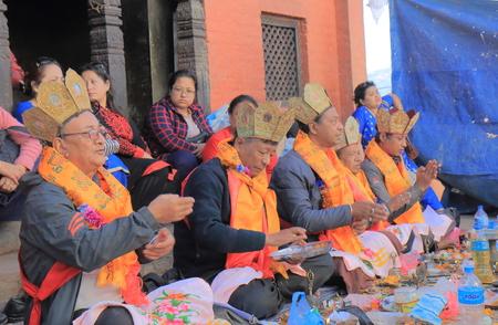 Kathmandu Nepal - November 11, 2017: Unidentified saints pray at religious ceremony at Swayambhunath Stupa temple Kathmand u Nepal.