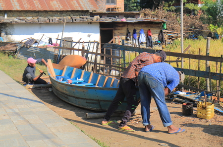 Pokhara Nepal - November 7, 2017: People build boat in Pokhara Nepal.