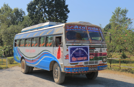 Pokara Nepal - November 8, 2017: Local school bus parked in downtown Pokhara Nepal.
