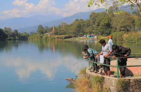 Pokhara Nepal - November 8, 2017: People fish at Dam Side Park in Pokhara Nepal.